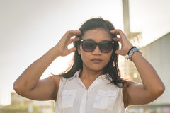 Beautiful asian lady in sunglasses looking in the camera Stock Photography