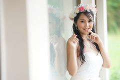 Beautiful Asian lady in white bride dress Royalty Free Stock Photos