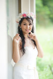 Beautiful Asian lady in white bride dress Stock Photos