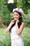Beautiful Asian lady white bride dress, posing in the forest Stock Images