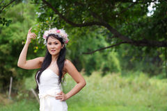 Beautiful Asian lady white bride dress, posing in the forest Royalty Free Stock Images
