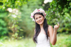 Beautiful Asian lady white bride dress, posing in the forest Royalty Free Stock Photos
