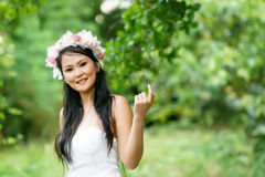 Beautiful Asian lady white bride dress, posing in the forest. Beautiful Asian lady in white bride dress, posing in the forest, greenery in the background, model Stock Photos