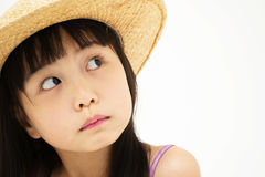 Beautiful asian little girl thinking Stock Images