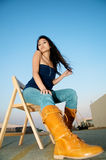 Beautiful Asian Model on chair Royalty Free Stock Photography