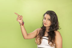 Beautiful asian model point her finger up Royalty Free Stock Photos