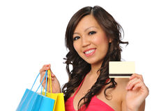 Beautiful asian model posing with shopping bags Stock Photography