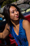 Beautiful Asian Model Sitting in a Blue Dress Royalty Free Stock Image
