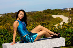 Beautiful Asian Model Sitting in a Blue Dress Stock Photos