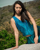 Beautiful Asian Model Sitting in a Blue Dress Stock Images