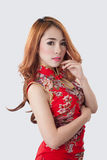 Beautiful Asian model wearing Cheongsam. Isolate on white Royalty Free Stock Image