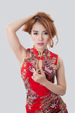 Beautiful Asian model wearing Cheongsam. Isolate on white Stock Images
