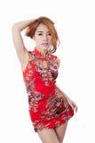 Beautiful Asian model wearing Cheongsam. Isolate on white Royalty Free Stock Photo