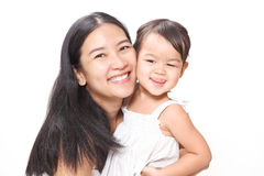 Beautiful Asian Mother and Adorable Baby Girl Hugging with Love and Happiness. Royalty Free Stock Photography
