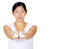 Beautiful Asian mother holding baby shoes. On white Stock Images
