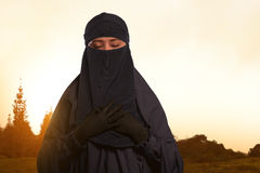 Beautiful asian muslim female in veil with niqab standing Stock Images