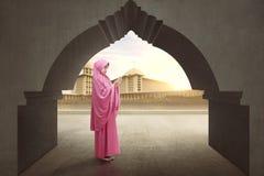 Beautiful asian muslim female wearing veil raising hand and pray Royalty Free Stock Photo
