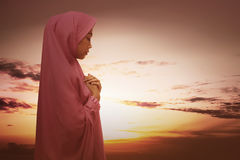 Beautiful asian muslim woman with hijab praying Stock Images