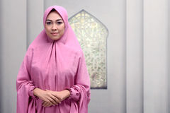 Beautiful asian muslim woman with smiley face standing. In the mosque royalty free stock images