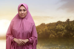 Beautiful asian muslim woman in veil with smiley face standing Stock Photos