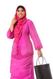 Beautiful asian muslimah woman with black wicker tote bags.Isolated Stock Photos
