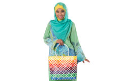 Beautiful asian muslimah woman with bright wicker tote bag.Isolated Stock Photo