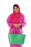 Beautiful asian muslimah woman with green wicker tote bags.Isolated Stock Image