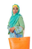 Beautiful asian muslimah woman with orange wicker tote bag.Isolated Stock Photos