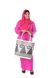 Beautiful asian muslimah woman with wicker tote bag.Isolated Royalty Free Stock Image