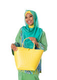 Beautiful asian muslimah woman with yellow wicker tote bag.Isolated Stock Images