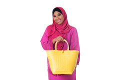 Beautiful asian muslimah woman with yellow wicker tote bag.Isolated Royalty Free Stock Photos