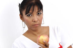 Beautiful Asian nurse holds apple Royalty Free Stock Image