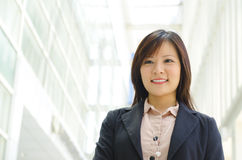 Beautiful Asian officer. Walking by modern building Stock Photography