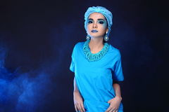 Beautiful Asian Patient Woman with fashion make up, blue tone ac. Cessory and shirt hygiene hat, studio lighting dark black background, copy space Stock Photos