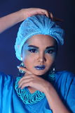 Beautiful Asian Patient Woman with fashion make up, blue tone ac. Cessory and shirt hygiene hat, studio lighting dark black background, copy space Royalty Free Stock Photos