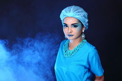 Beautiful Asian Patient Woman with fashion make up, blue tone ac. Cessory and shirt hygiene hat, studio lighting dark black background, copy space Royalty Free Stock Images