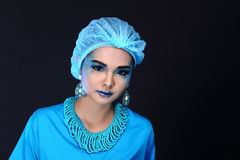 Beautiful Asian Patient Woman with fashion make up, blue tone ac. Cessory and shirt hygiene hat, studio lighting dark black background, copy space Royalty Free Stock Photography