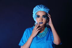 Beautiful Asian Patient Woman with fashion make up, blue tone ac. Cessory and shirt hygiene hat, studio lighting dark black background, copy space Stock Image