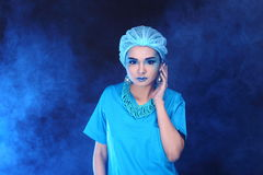 Beautiful Asian Patient Woman with fashion make up, blue tone ac. Cessory and shirt hygiene hat, studio lighting dark black background, copy space Stock Images
