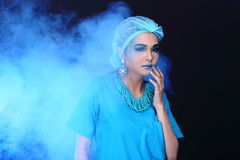 Beautiful Asian Patient Woman with fashion make up, blue tone ac. Cessory and shirt hygiene hat, studio lighting dark black background, copy space Royalty Free Stock Image