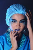 Beautiful Asian Patient Woman with fashion make up, blue tone ac. Cessory and shirt hygiene hat, studio lighting dark black background, copy space Stock Photography