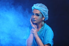 Beautiful Asian Patient Woman with fashion make up, blue tone ac. Cessory and shirt hygiene hat, studio lighting dark black background, copy space Stock Photo