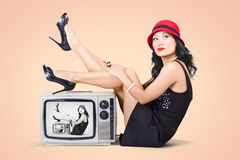 Beautiful asian pin up girl posing on retro tv set Stock Image