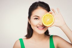 Beautiful asian portrait of young woman with oranges. Healthy food concept. Skin care and beauty. Vitamins and minerals royalty free stock photo