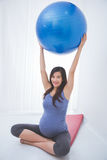 Beautiful asian pregnant woman doing exercise with a yoga ball, Stock Images