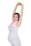 Beautiful asian pregnant woman exersicing, isolated Stock Image