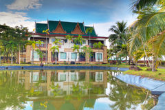Beautiful Asian resort reflected in pond Royalty Free Stock Image