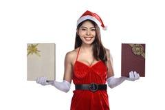 Beautiful asian santa woman holding gift box Royalty Free Stock Photos