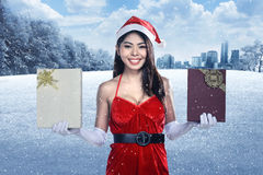 Beautiful asian santa woman holding gift box Stock Image