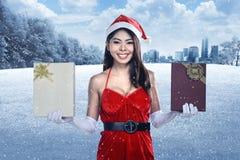 Beautiful asian santa woman holding gift box Stock Image